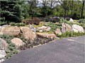 <b>Custom Natural retaining wall</b><br>Picture of natural rock retaining wall construction.